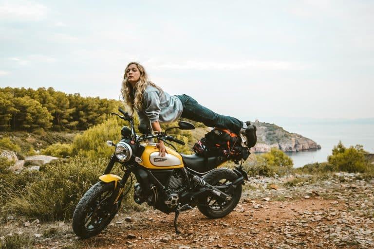 woman on yellow motorcycle
